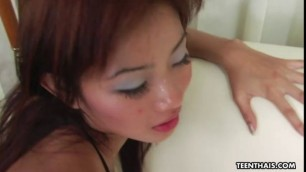 Thai chick claudia opens her fishnet tights for a white cock